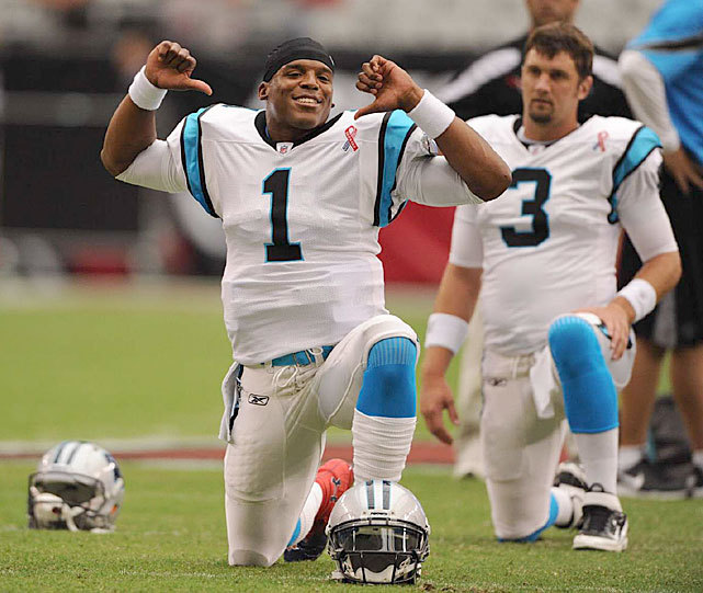 Panthers quarterback Cam Newton jokes around prior to a Sept. 2011 game against the Cardinals. Newton, the No. 1 overall pick last year, led the Panthers to a 6-10 record in his first season. Carolina should be improved next season with the addition of wide receiver Joe Adams and cornerback Josh Norman, who were both drafted over the weekend. SI's Chris Burke gave the Panthers a grade of A- for their draft. Find out the grades for every team below. (John W. McDonough/SI) BURKE: Handing out 2012 draft grades for every teamPAULINE: Steals, reaches from the 2012 NFL DraftKING: Biggest first-round stunner and more thoughtsGALLERY: Cam Newton's Road To Stardom