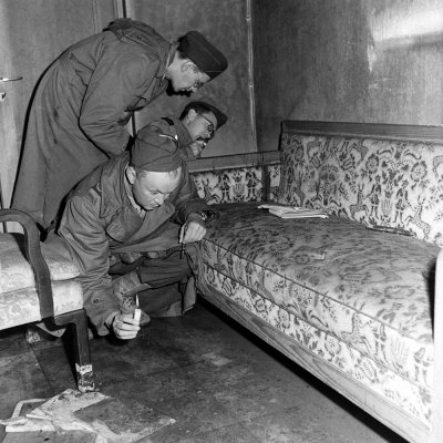 "life:  April 30, 1945: Hitler commits suicide.In the spring of 1945, LIFE's William Vandivert was one of the first photographers to document the ruins of Berlin and the burned-out bunker beneath the city where Hitler and Eva Braun spent their final hours In his typed notes to his editors in New York, Vandivert described in detail what he saw. For example, of the sixth slide in this gallery he wrote:   ""Pix of [correspondents] looking at sofa where Hitler and Eva shot themselves. Note bloodstains on arm of soaf [sic] where Eva bled. She was seated at far end … Hitler sat in middle and fell forward, did not bleed on sofa. This is in Hitler's sitting room.""   Remarkable stuff — but, it turns out, only about half right. Historians are now quite certain that Braun actually committed suicide by biting a cyanide capsule, rather than by gunshot — meaning that the blood stains on the couch might well be Hitler's, and not Eva Braun's, after all. Read more here."