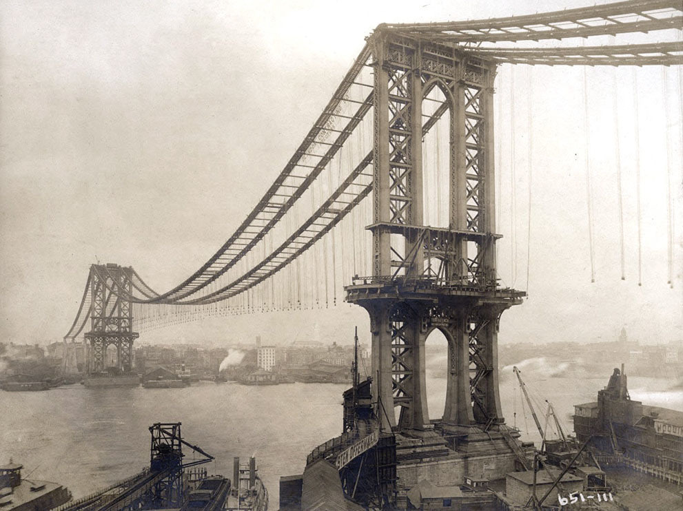 Manhattan Bridge, under-construction, seen from the roof of Robert Gair Building, showing suspenders and saddles, on February 11, 1909. (Eugene de Salignac/Courtesy NYC Municipal Archives)  The New York City Municipal Archives just released a database of over 870,000 photos from its collection of more than 2.2 million images of New York throughout the 20th century. Their subjects include daily life, construction, crime, city business, aerial photographs, and more.  These are incredible. Check them out. A compilation of some of the best are here courtesy of The Atlantic.