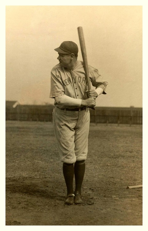 The Newest Yankee - 1920 Babe Ruth strikes a pose in his first Yankees uniform. Looks like this was taken during spring training.