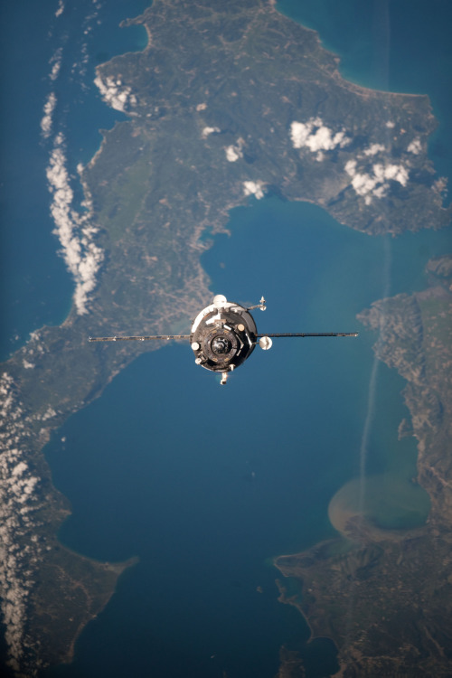 unknownskywalker:  Progress 47 approaches the ISS An unpiloted Progress resupply vehicle approaches the International Space Station, carrying 2.8 tons of food, fuel and supplies. The cargo delivery includes 1,988 pounds of propellant, 110 pounds of oxygen and air, 926 pounds of water and 2,703 pounds of spare parts, resupply items and experiment hardware for the residents of the space station. Progress 47 docked to the station's Pirs Docking Compartment at 10:39 a.m. (EDT) on April 22, 2012. In the background are the northeast part of the Greek Island of Corfu; the strait of Corfu (center); and the Greek-Albanian mainland (top-top right). The city of Kerkyra (Corfu) is on seen the island at bottom-center.