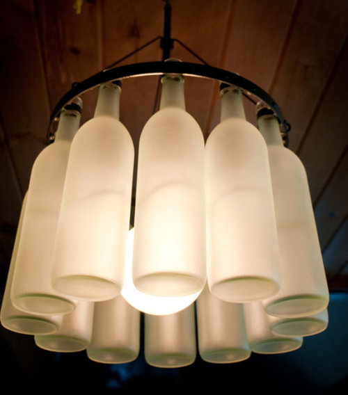 This frosted wine bottle chandelier is a great idea for a wedding & can be usable in the home afterwards as well!