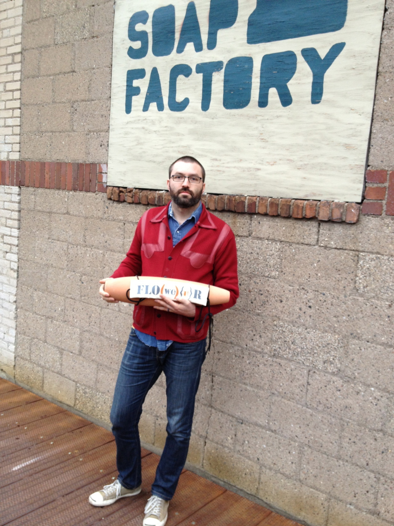 On Saturday night Colin & I went to The Soap Factory to experience Joe Madrigal and Amber Ginsburg's FLO(WE){U}R project. Throughout the night the artists were busy making clay bomb casings, re-imagined as seed shakers. Visitors were invited to fill them with seed mix and to take them outside for a walk around the neighborhood, scattering seeds. A century ago, similar terra cotta casings were manufactured, filled with baking flour, and used as test bombs. In this project, the artists used those original blueprints to create something entirely different and generative.  There are a couple of seed-scattering bike rides planned for the coming weeks, and an event as part of the Northern Spark festival on June 9th. All of that information can be found on The Soap Factory's website.