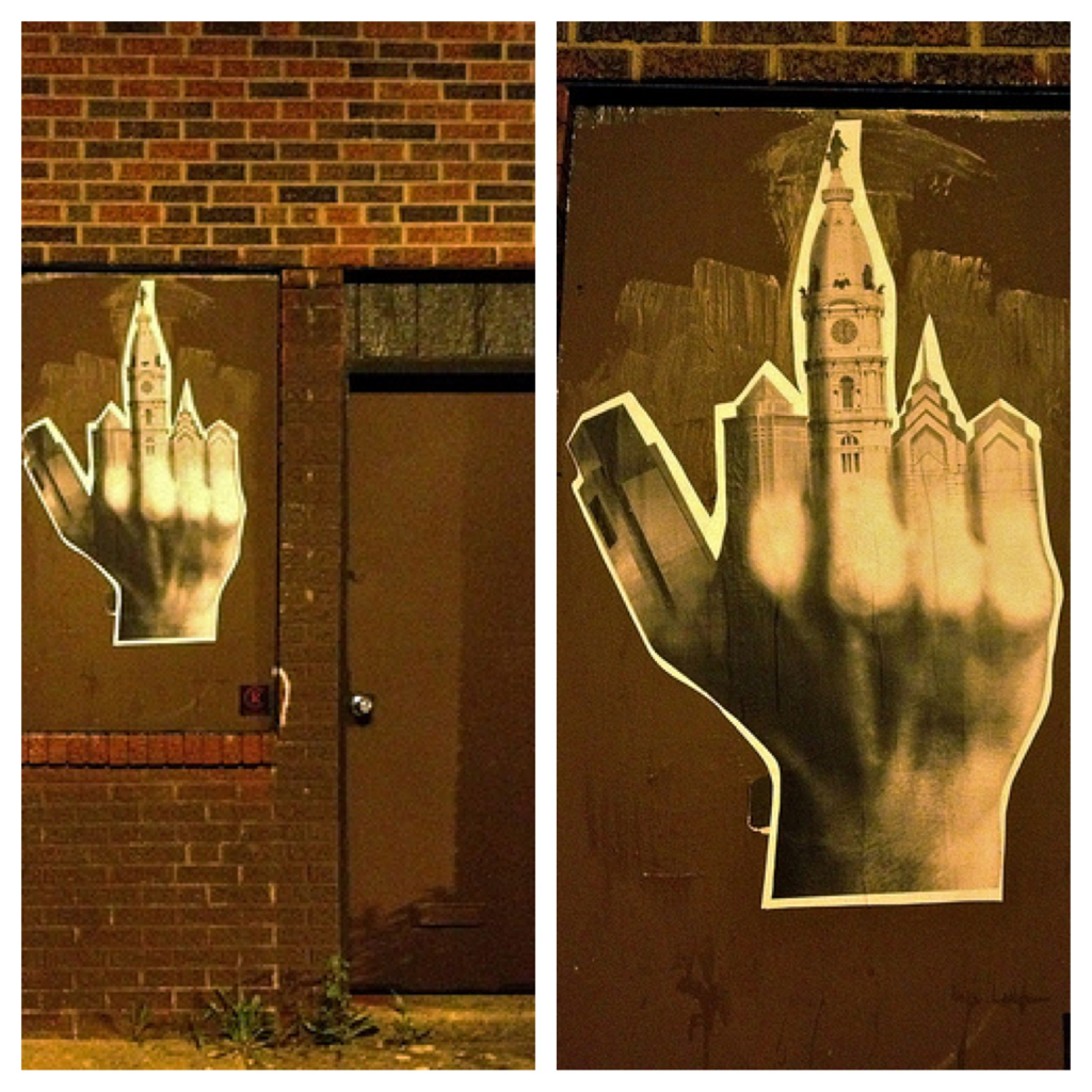 Who's Giving Philly The Finger?  Streetsdept, a blog that uncovers the Philly Street Art Scene reported on the new paste featuring Philly's Skyline that popped up over the weekend on Front st. in Fishtown.  …still no clue who the artist behind it is. But they have captured a funny Philadelphian attitude.   *photo by Conrad Benner (@streetsdept)