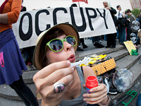 Occupy Wall Street: Back, But Does Anyone Care? After spending 2011 near the top of the news headlines, Occupy Wall Street finds itself in a struggle to regain relevance as a grassroots protest against corporate greed and Washington corruption.  The movement hopes to regain some of its mojo Tuesday, when it stages a nationwide May Day protest and celebration that will focus on a broad agenda of causes it hopes to push.  Full Story  Photo: Getty Images
