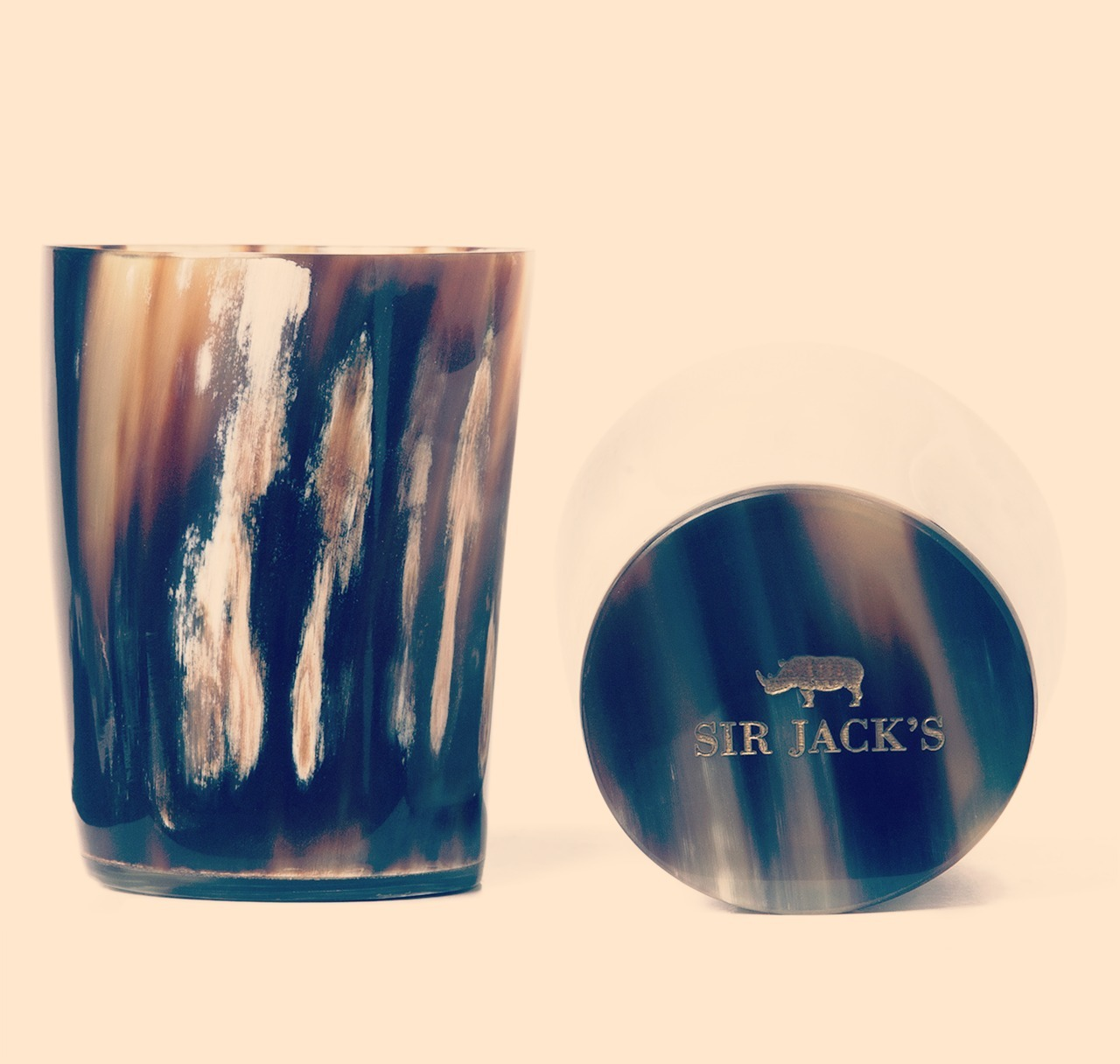 whereisthecoool:  Ox Horn Whiskey Tumblers Elevate your bar with these ox horn tumblers from Sir Jack's. Handcrafted in England from natural horn and polished to perfection, you'll be looking for any reason to bust these out. Sold in sets of two, because good whiskey goes best with good company.  (Via Surplus)