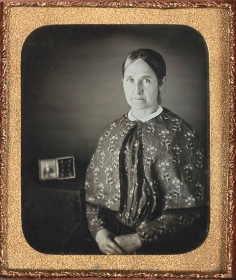 ca. 1850, [daguerreotype portrait of a woman with a daguerreotype of a gentleman, presumably her husband] via the Nelson-Atkins Museum, Photography Collection