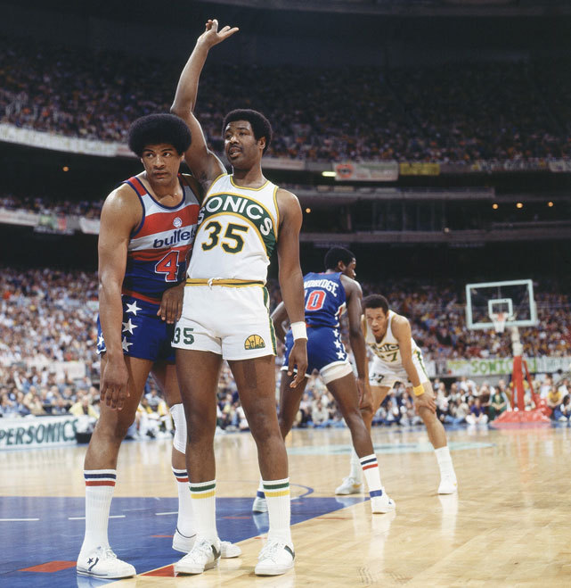 Wes Unseld (43) guards Paul Silas during a 1978 Bullets-Sonics game. Silas was fired by Charlotte on Monday after coaching the Bobcats to the worst season in NBA history (7-59). (Peter Read Miller/SI) ROSENBERG: Jordan to blame for Bobcats miserable season