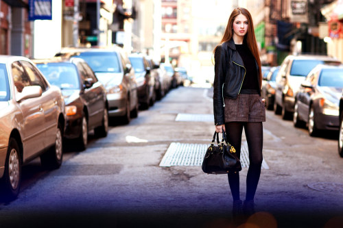 STREET STYLE // NYC 365 - A statement bag and long, sleek hair make short-shorts and leather ladylike. Her smoky eyes take her from day to evening! #bornwithit