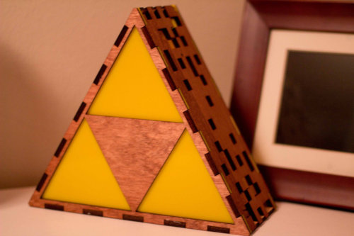 nikoanesti:  it8bit:  Triforce Lamp Created by The Back Pack Shoppe PREORDER a hanging or end table version for $95 USD at Etsy.  Fandom and all aside, that's just a really nice lamp. Or perhaps I just like the cozy atmosphere of the first photo.