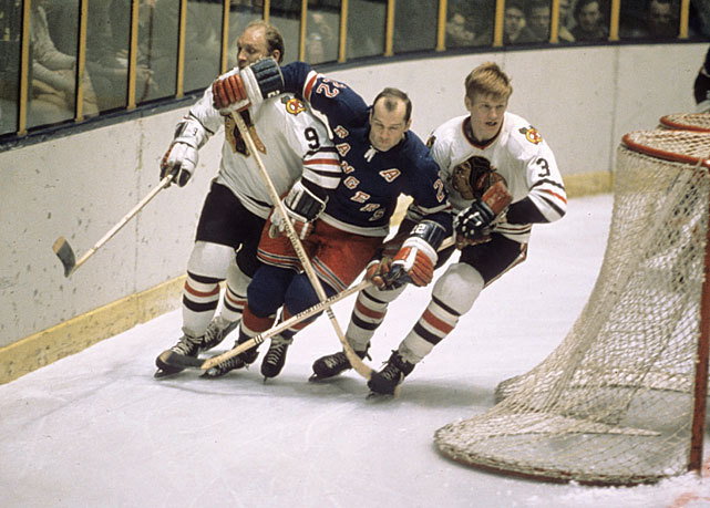 Rangers forward Don Marshall skates past Bobby Hull and Keith Magnuson during a 1969 game against the Blackhawks. While Chicago was knocked out of the playoffs by Phoenix in the first round, New York has a 1-0 lead over Washington in their second round series. (Walter Iooss Jr./SI) PREVIEW: Shaken Capitals try to get even with Rangers