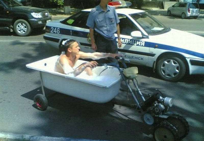 "collegehumor:  Cop Pulls Over Man Driving Bathtub ""To the bathmobile!"""