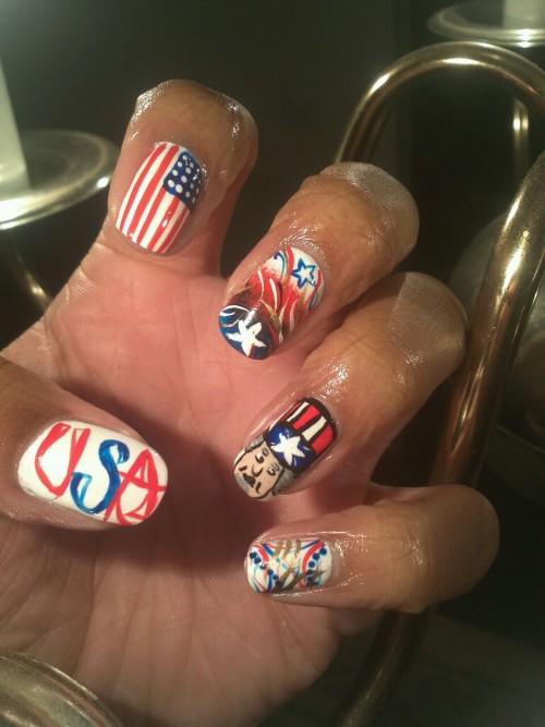 thenaillab:  My USA nails I did for a competition… I used white polish as my base color, and red, blue, black, & gold acrylic paints.