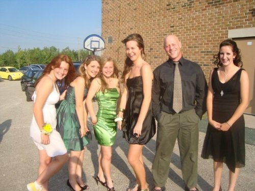 "Grade 8 graduation (5'11"") with my teacher and some of my classmates. I'm in flats while 3 of the other girls are in heels"