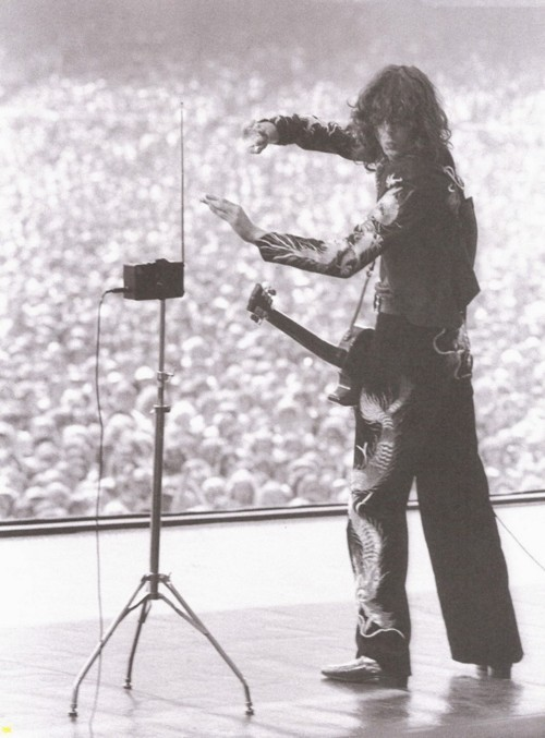 holy shitonkey balls, that is Jimmy Page playing a theremin. everything else is now irrelevant.