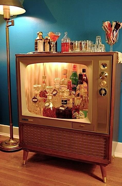 Okay, show of hands: Who's with me on this: This TV-bar upcycling idea is even better than the TV-turned-pet-bed project. (Maybe pair it with this repurposed library card catalog??)