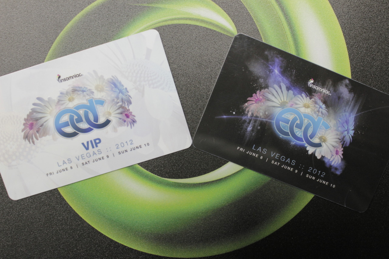 I promised you guys I'd take a picture of the new EDC 2012 tickets on Monday when it was allowed :) And here they are! The white one is for VIP, and the black one is for general admission. What is special about them this year is that they are stratch-n-sniff! :D It is supposed to smell like daisies. Pretty cool idea I guess, haha.