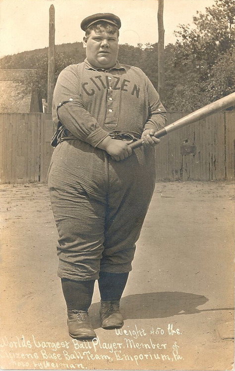 Designated eater at bat. Inscription says 450 lbs baseball player for The Citizens of Emporium, Pennsylvania. Postcard dated August 1, 1908. From John McNab via mudwerks
