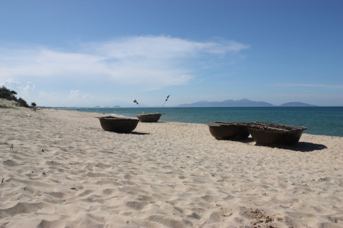 As we hung out on An Bang beach, near Hoi An in Vietnam, a couple of foreigners came over and hung a bunch of their stuff all over one of these fishing boats, draping bags of fruit on fishing gear, laying out wet clothes … After an hour or so, an absolutely enraged fisherman came over and starting screaming at them and feigning that he was going to kick them. We couldn't help laughing at them as they desperately tried to get all their bags and crap off the boat. Before they even got everything together, he ran out to the water and filled a bucket and ran back and started dumping it all over his boat, splashing a bit on their feet as they tried to get away. Get those tourist germs off! (What the hell were they thinking anyway. Chairs/lounges on An Bang are free to hang out on, just buy a bottle of water … you don't need to act like you own someone else's fishing boat and gear.) Anyway, An Bang definitely ended up being a highlight of our 2 weeks in Vietnam. We hope to get back and visit the guys at Banyan soon!
