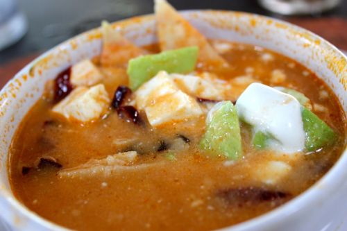 mexicanfoodporn:  ALERT: HARDCORE MEXICANFOODPORN!!!!!!!!!!! Sopa Azteca Aztec Soup which is sauteed garlic, onions and tomatoes mixed with chicken soup and then its seasoned with epazote. Finally fried pieces of tortillas, avocado, crema and chipotle peppers  this is seriously making me want to cry