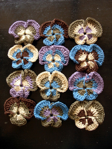 Crocheted Pansies Handmade by Mind of Winter and here is a link to the Japanese motif dictionary that contains the pansy pattern. Gorgeous right?