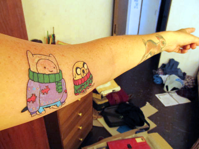 'My Adventure Time tattoo. My name is Beibi, I live in Santiago,Chile.' Aw Finn and Jake in their Christmas sweaters. Thanks beibiylosanimales for the submission!
