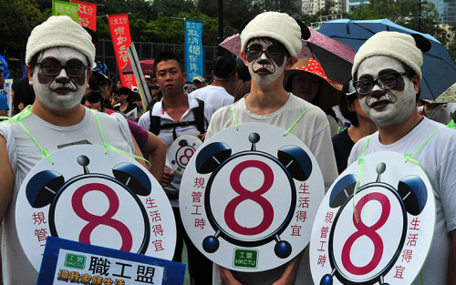 Photograph: Laurent Fievet/AFP/Getty Images May Day activists in Hong Kong - and more images from protests and demos around the world.