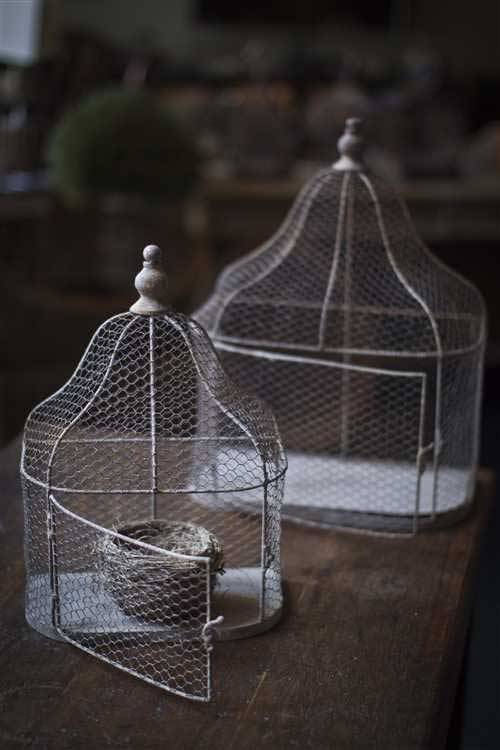 source: Mothology ~ I like this set of two metal bird cages