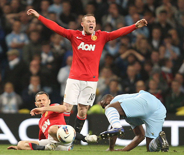 Manchester United forward Wayne Rooney appeals for a decision during yesterday's match against Manchester City. Vincent Kompany scored the only goal of the day as City defeated United 1-0 as they try and claim their first Premiere League title since 1968. (Matthew Peters/Man Utd via Getty Images) BERLIN: City prevails in Manchester Derby