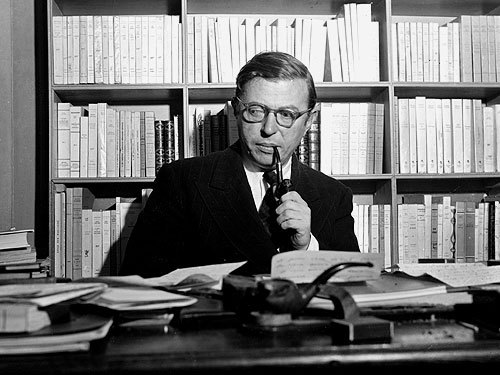 More like gazes contemptuously.  awesomepeoplereading:  Sartre reads.