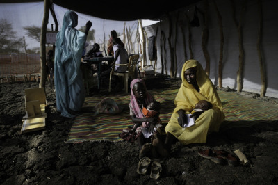Emergency Response Scaled Up as Violence Continues in South Sudan  Tensions and hostilities continue unabated between South Sudan and its northern neighbor Sudan, and MSF is scaling up its emergency response by treating people injured in the latest violence, giving material and staff support to local clinics and hospitals, and providing relief to people displaced by the fighting.  MSF currently provides life-saving surgery in Aweil and Agok for patients wounded in the recent violence. The organization also reinforced its surgical response capacity in case of a general degradation of the situation.  MSF has also donated medicines and medical supplies to local hospitals in Abiemnom and Bentiu in Unity State, both of which have received high numbers of wounded from the recent clashes. Two of MSF's medical staff have been temporarily seconded to support the Bentiu hospital.Photo: South Sudan 2012 © Robin Meldrum/MSF Refugees from Blue Nile State in Jamam refugee camp