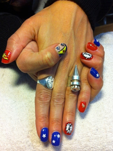fashiontipsfromcomicstrips:  Manicure Monday: Wonder Woman nails, by Marie NAILS SOHO. The best Wondy manicure that I've seen yet!