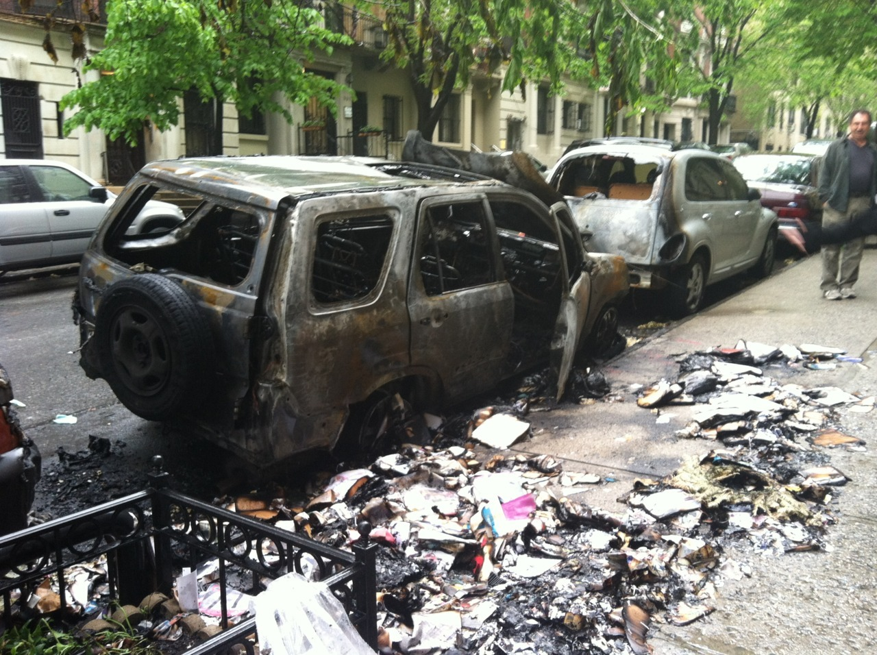 Garbage fire destroyed a vehicle on W. 100th St.