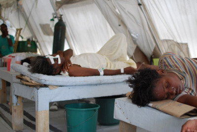 "Haiti's Rainy Season Brings Cholera Back to Port-au-Prince and Léogâne  With the rainy season now underway in Haiti, MSF has seen an increase in the number of cholera patients. Admissions to MSF's treatment centers in Port-au-Prince and Léogâne have more than tripled in less than one month.   New patients arrive daily at MSF's cholera treatment centers (CTCs). A woman named Marie was admitted to the Martissant CTC on April 16. ""I had diarrhea and was vomiting a lot, then I fainted,"" she recounted. ""A relative brought me here because it is the center closest to where I live. The doctors told me that I had cholera and was dehydrated."" One hundred thirty-four other people like Marie arrived at the MSF center in Martissant between April 16 and 23 and nearly 400 more went to MSF's other CTCs in Port-au-Prince and Léogâne. ""Cholera is easy to treat but specialized treatment centers must be accessible and patients must be brought there as soon as possible once symptoms appear,"" says Dr. Sophie Duterne, MSF's medical coordinator in Haiti. ""If left untreated, this disease can kill within a few hours. Treatment involves simple oral or intravenous rehydration, with antibiotics for the most severe cases. However, taking additional hygiene precautions and drinking disinfected water is still the best protection."" Since the first cases were identified in October 2010, more than 500,000 Haitians have contracted cholera.Photo: Haiti 2012 © Mathieu Fortoul/MSF Cholera patients recover in MSF's Martissant CTC."