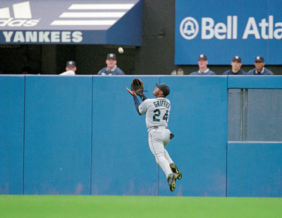 Best CF ever siphotos:  Ken Griffey Jr. makes a running catch during a 1999 Mariners-Yankees game. (V.J. Lovero/SI) GALLERY: Ken Griffey Jr. Through the Years