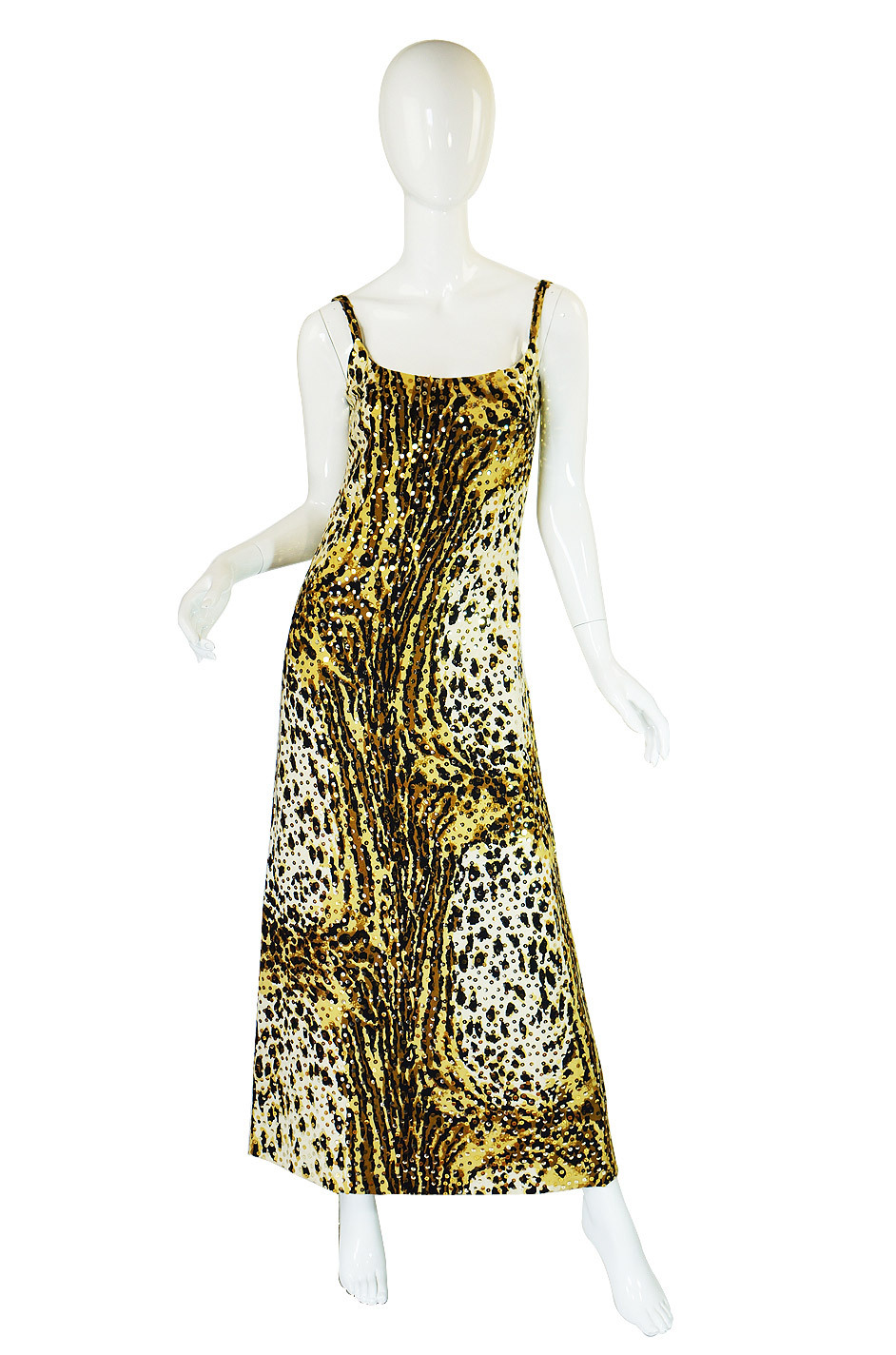 A dramatic  1970s Mollie Parnis Sequin Leopard Maxi just listed!