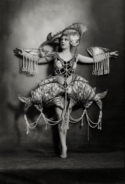 Nude woman in aquatic costume of pearls. Photographed by Lucien Walery c. 1920