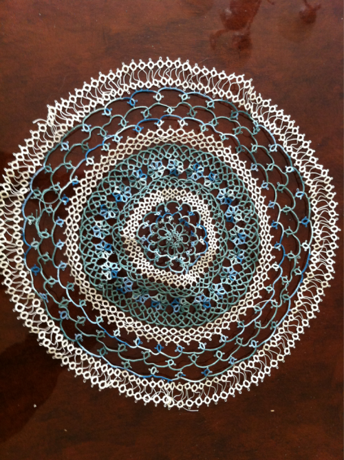 Work in progress. Still.  I'm actually pretty pleased with this doily. Last time I tatted a doily of this magnitude, it took me the better part of a year. This one is 2/3 done. At this rate I should be done by the time school starts again. I'm going to assume I am just a much faster tatter now vs. then, because there is no possible way I have more time now..