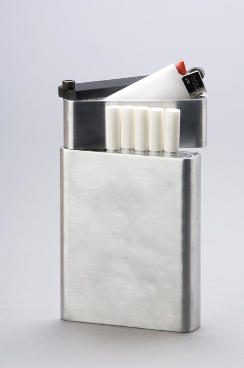 "The Pivot.c Cigarette Holder. For those with the common habit of ""misplacing"" their lighters here's your solution. With two sections, one for your wandering lighter as well as one for your cigarettes, up to eight to be exact, this holder seems like every smokers prayers have been answered. Made with aluminum as well as acrylic paneling this sleek and modern design is pleasing to any minimalistic eye and will keep your vanishing lighters in check! No word yet on where or when these will be available to the general public for purchasing but will definitely keep an eye out."