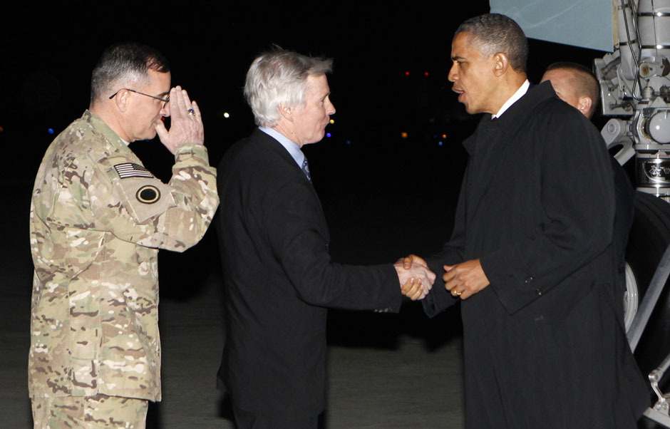 reuters:  DEVELOPING: U.S. President Barack Obama shakes hands with U.S. Ambassador to Afghanistan Ryan Crocker upon his arrival at Bagram Air Base in Kabul, Afghanistan May 1, 2012. [REUTERS/Kevin Lamarque] READ MORE: Obama lands in Afghanistan on OBL death anniversary  He knows how to show up at just the right time, doesn't he?