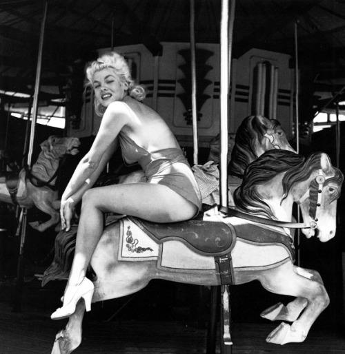 Maria Stinger photographed by Bunny Yeager at Funland Kiddie Park c. 1950's