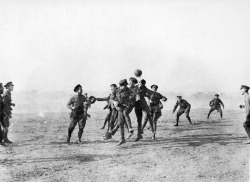 Playing football during the Christmas Truce, (1914).