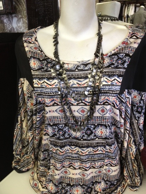 Do some sun-bathing at the beach in this wonderful Southwestern-inspired raglan sleeve sheer top. With a unique cut and winged sleeves, this top has it all. We love the blend of sheer black fabric with the print. Pair with a sparkling gun metal feather necklace ($24) or a swimsuit for your next beach day.