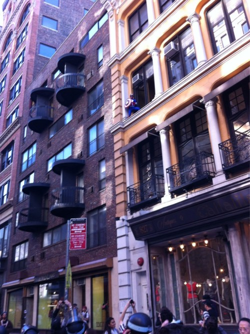 Captain America salutes the Occupy Wall Street protesters marching down Broadway to Wall Street. (photo from @macfathom)