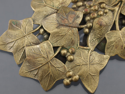 (via Vintage large pretty Leaf and Grape vine brooch by KSkilesJewelry)  the vintage piece that inspired me to learn to make my own jewelry