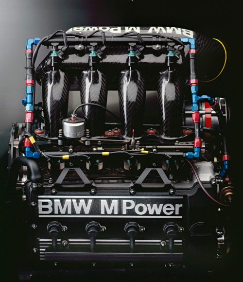 "beautifullyengineered:  BMW S14 - DTM Version Excerpts regarding this engine from the article ""25 years ago a champion in touring car racing, the E30 M3 was born."" Full article is here. ""…Four cylinders meant less weight and high torque, an ideal platform for a sports engine in the projected displacement class. Naturally enough, the series four-cylinder engine was much too tame for a sports engine. A comprehensive power boost was called for in order to turn the plucky daily workhorse into an athletic and sporty power unit. The BMW design engineers increased the displacement to 2.3 liters and applied a formulation that had already achieved significant successes over a period of many years: four-valve engineering. There was also another reason for the decision to opt for a four-cylinder engine and not adopt the six-cylinder engine introduced in the BMW 3 Series. The longer crankshaft in the big engine started to vibrate much earlier than the shorter four-cylinder shaft. The design engineers therefore designed the crankshaft drive of the BMW M3 with sufficient torsional stability to achieve 10,000 revolutions a minute and more. By comparison with the four-cylinder engine installed in the series vehicles, this represented an increase of more than 60 percent.Paul Rosche recalls: ""We started work immediately. One advantage was that the big six-cylinder engine originally had the same cylinder gap as the four-cylinder engine. We therefore cut two combustion chambers off the four-cylinder head of the M88 and bolted a panel over the hole on the rear side."" This meant that the new four-cylinder engine had a second forebear. The six-cylinder engine that had initially created a sensation in the M1 and had meanwhile transformed the M635CSi into one of the fastest coupés in the world. Paul Rosche: ""Whether you believe it or not – we had created an outstanding four-cylinder engine for the 3 Series within the space of two weeks. Under the development name S14, this engine was to generate headlines in sport and in volume production over the years to come…. …A World Touring Car Championship was held for the first time in 1987. And that was exactly what the M3 had been built for. But not quite in the guise in which it was seen on the streets. Instead of 200 hp, the 2.3 litre engine delivered up to 300 hp at 8,200 rpm in the racing version. This put it on a par with the BMW M635CSi…."""