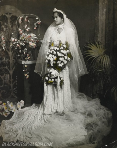 Here Comes The Bride | 1920s African American bride posing for her formal wedding portrait, circa 1920s. Note the touch of color in her bouquet. James Van Der Zee, photographer. African American Vernacular Photography courtesy of Black History Album. FIND US ON TWITTER | FACEBOOK | TUMBLR | FLICKR | PINTEREST