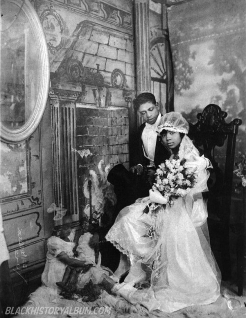 Here Comes The Bride II | 1920s African American bride and groom posing for their formal wedding portrait, circa 1920s. Note the ghostly image of a child next to the newlyweds possibly suggesting the couple's future. James Van Der Zee, photographer. African American Vernacular Photography courtesy of Black History Album. FIND US ON TWITTER | FACEBOOK | TUMBLR | FLICKR | PINTEREST