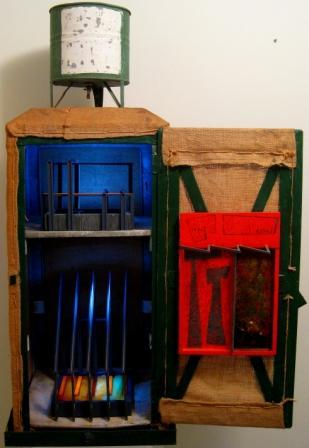 Title: Munday Swamp Artist LoisHayes has transformed a Coolgardie safe from the Mundaring and Hills Historical  Society to make an insightful visual comment on a unique piece of Perth's natural heritage: Munday Swamp Very high species richness: 87 bird species 20 reptile species including rare Crowned Snake Western Swamp Tortoise 8 frog species 2 mammal species – Quenda and Echidna 2 Western Australian endemic fish populations – Western Minnow and Western Pygmy Perch. Seasonal food, habitat and breeding recourses for many bird species including; waterbirds, honey eaters Carnaby's Black Cockatoo and northern migrants. Now home for diverse industry including;  warehousing and distribution park, heavy machinery operations, rail freight terminal, international and domestic airport.