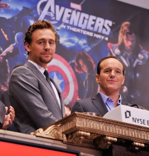 Tom Hiddleston and Clark Gregg pose for a photo as part of a celebration of the release of Marvel Studios' 'Marvel's The Avengers' after ringing the opening bell at the New York Stock Exchange on May 1, 2012 in New York City.